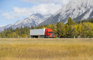 Image of truck driving near mountains