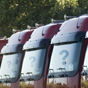Image of trucks with question marks on windshields